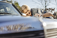 Woman cleaning her car - JOSF00878