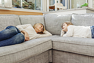 Mature woman and girl at home lying on couch - JOSF00893