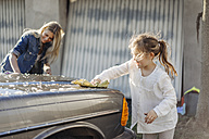 Mature woman and girl cleaning car together - JOSF00944