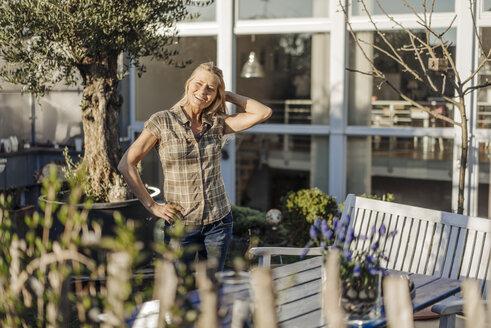 Happy woman in garden - JOSF00953