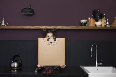 Girl inside a cardboard box painted with a panda - PSTF00016