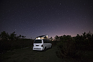 Camper with roof tent in the nature under starry sky - STCF00312