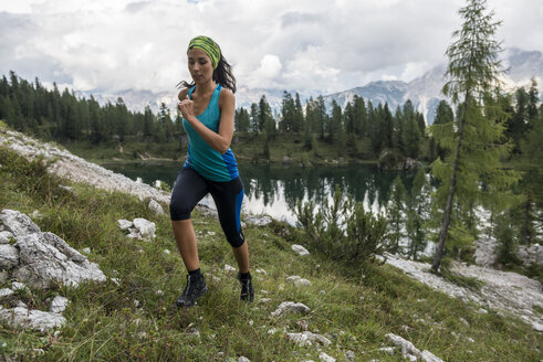 Italy, Dolomites, Veneto, trail runner at Federa Lake - ZOCF00295