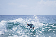 Boy surfing in the sea - SIPF01637