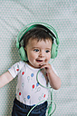 Portrait of baby girl with headphones - GEMF01613