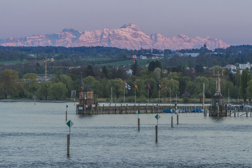 Germany, Constance, view to port entrance with Swiss Alps in background - KEBF00548