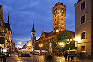 Poland, Torun, town hall at the old town marketplace by night - ABOF00194