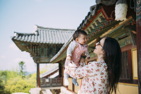 South Korea, Gyeongju, woman traveling with a baby girl in Bulguksa Temple - GEMF01618