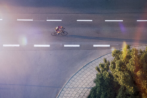 Racing cyclist on the street, drone photography - MMAF00093