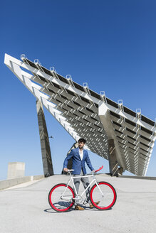 Young businessman with fixie bike outdoors - GIOF02569