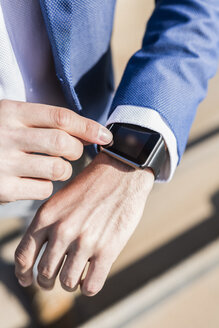 Close-up of businessman with smartwatch - GIOF02590