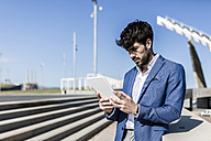 Young businessman using tablet outdoors - GIOF02605