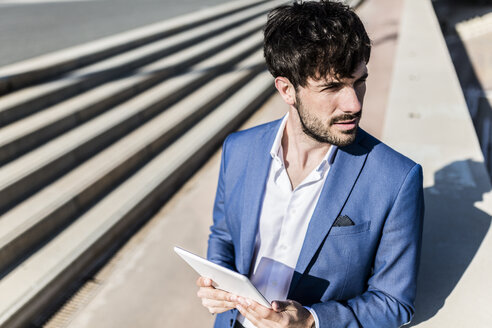 Young businessman holding tablet outdoors - GIOF02608
