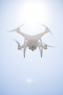 Flying drone with camera at backlight - MAEF12200