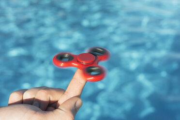 Finger balancing a fidget spinner - SKCF00296