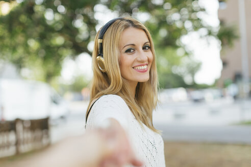Portrait of smiling blond woman with headphones - JPF00203