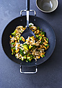 Fried noodles with chicken, broccoli and cashew nuts in a wok - PPXF00046