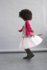 Fashionable girl dancing - FSF00873