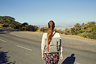 South Africa, Cape Town, Signal Hill, young woman on country road - SRYF00514