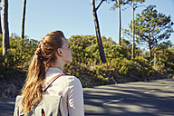 South Africa, Cape Town, Signal Hill, young woman on country road - SRYF00520