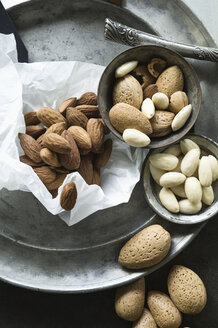 Peeled and whole almonds on tin plate - ASF06083