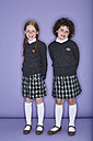 Portrait of two smiling girls wearing school uniform - FSF00891