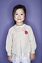 Portrait of smiling little girl wearing cardigan - FSF00897