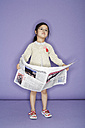 Portrait of pensive little girl with newspaper - FS00900