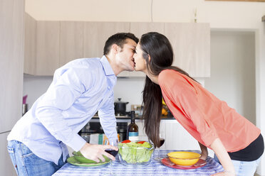Couple kissing in kitchen - FMOF00283