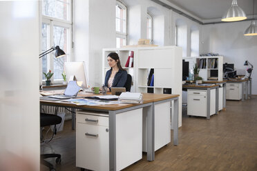 Woman working at desk in office - FKF02246