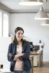 Portrait of confident woman standing in office - FKF02309