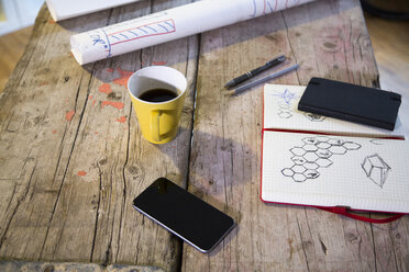 Notebook, smartphone and coffee cup in modern informal office - FKF02324