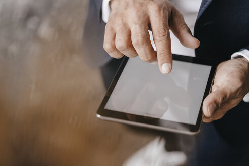 Close-up of businessman using tablet - KNSF01262
