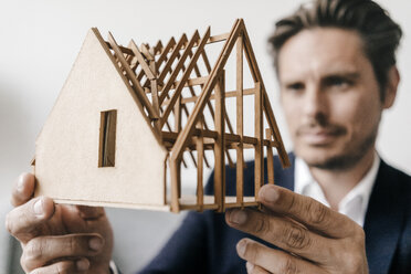 Close-up of architect examining architectural model - KNSF01274