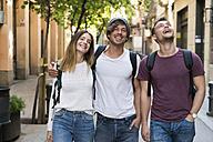 Happy friends walking in the city - KKAF00831