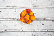Bowl of apricots on wood - LVF06130