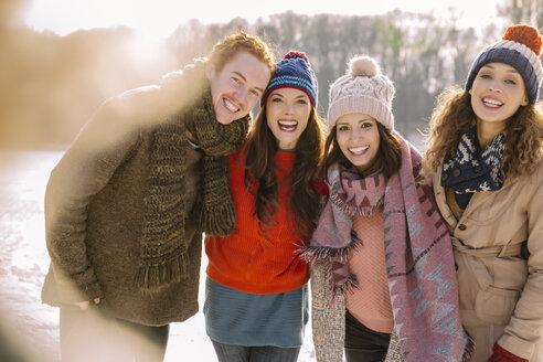 Portrait of happy friends outdoors in winter - MFF03533
