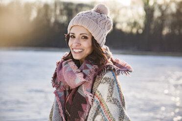 Portrait of happy woman outdoors in winter - MFF03557