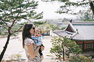 South Korea, Seoul, Mother and baby girl visiting Changdeokgung Palace and Huwon - GEMF01636