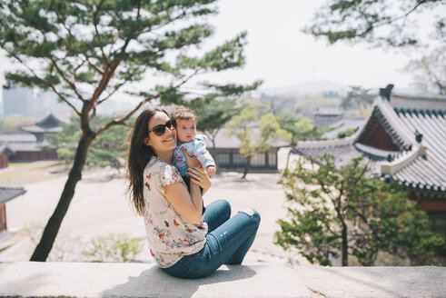 South Korea, Seoul, Mother and baby girl visiting Changdeokgung Palace and Huwon - GEMF01639