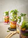 Preserving jar of wheat salad with vegetables, boiled egg and sliced steak - KSWF01814