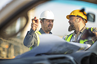 Quarry workers checking site plan - ZEF13720