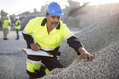 Quarry worker doing a quality check - ZEF13723