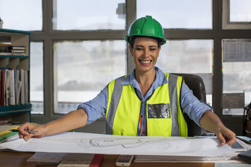 Female worker sitting in site office of quarry - ZEF13750