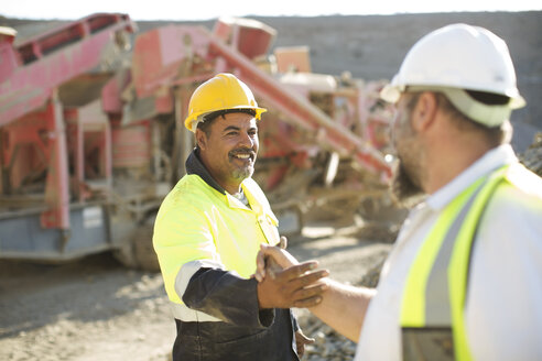 Two quarry workers shaking hands - ZEF13789