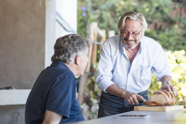 Two senior men together on terrace - ZEF13834
