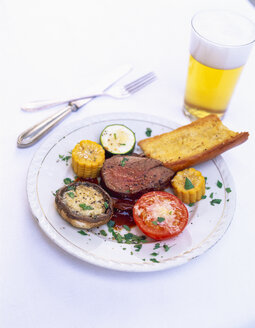 Beef fillet with grilled vegetables and glass of beer - PPXF00068