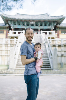 South Korea, Gyeongju, father traveling with a baby girl in Bulguksa Temple - GEMF01643