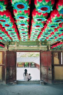 South Korea, Gyeongju, mother with a baby girl in Bulguksa Temple - GEMF01649