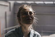 Young woman with glasses looking up - KNSF01464